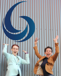 Volha and Leah from PolyDrop jumping below the company logo